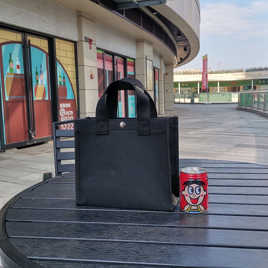 黑色手提包 手提袋帆布包折叠便携购物袋防水学生休闲环保袋女包黑色饭盒袋_推荐淘宝好看的黑色手提包