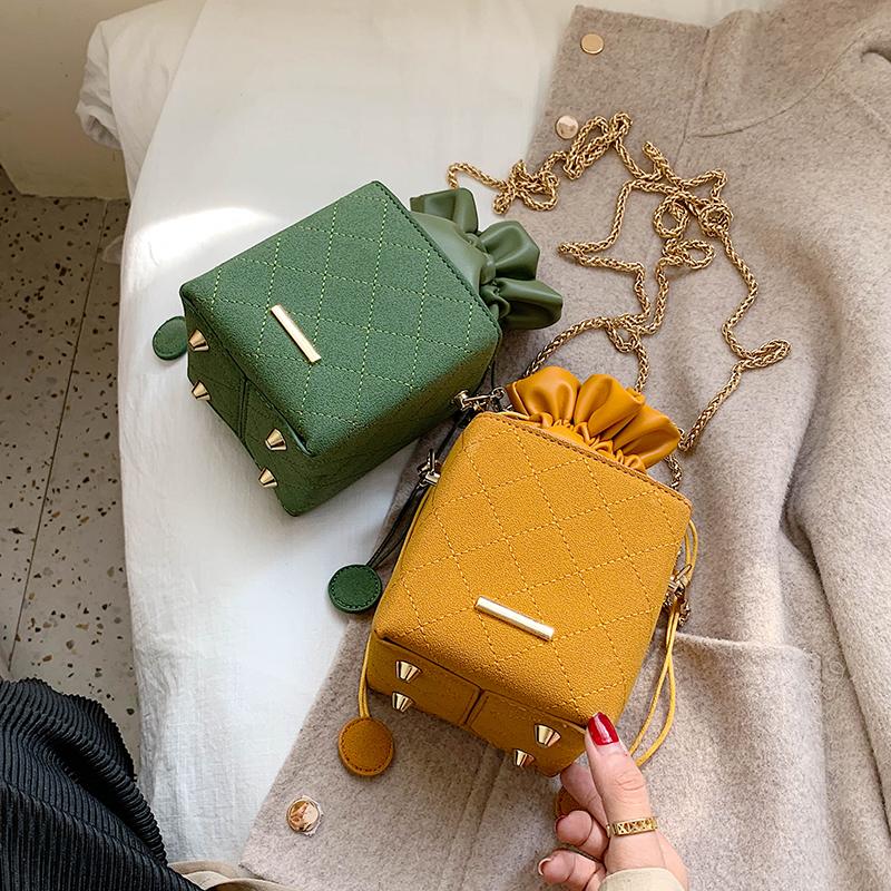 绿色水桶包 迷你小包包女2021早春新款真皮斜挎链条包绿色小方盒子抽带水桶包_推荐淘宝好看的绿色水桶包