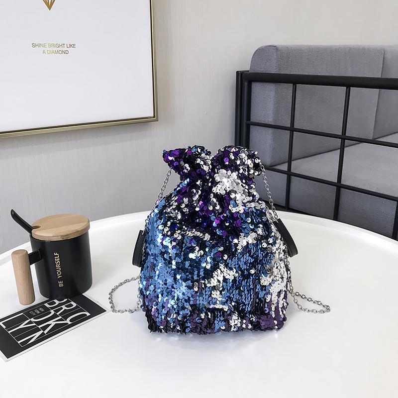 紫色水桶包 束口亮片手提水桶包新款链条抽带单肩小包包个性闪亮钱袋斜挎女包_推荐淘宝好看的紫色水桶包