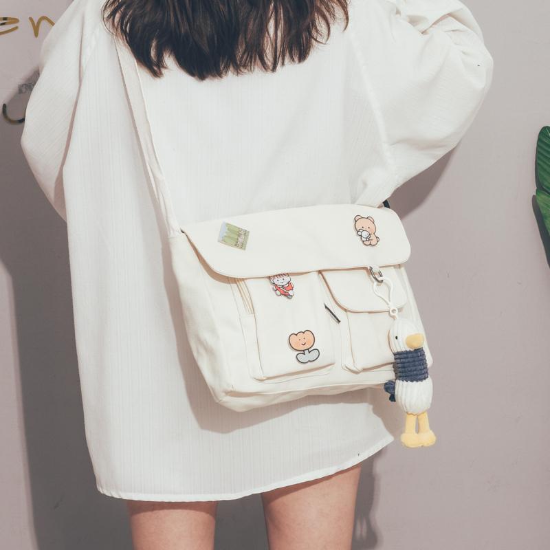 白色帆布包 大容量帆布包包女2020新款潮大学生上课的斜挎包女森系文艺邮差包_推荐淘宝好看的白色帆布包