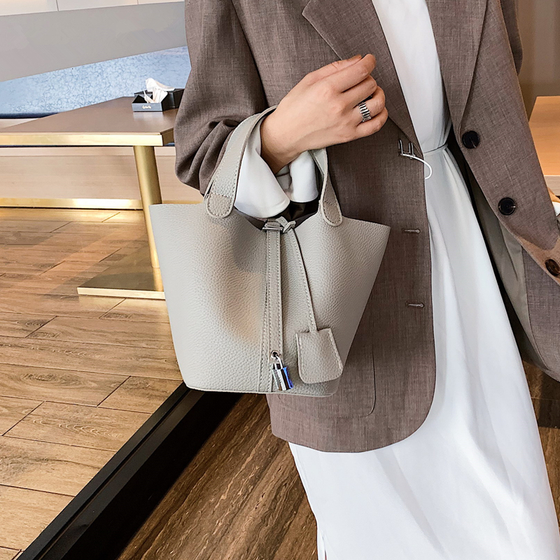 黄色手提包 菜篮子包2020新款手提包潮简约百搭女包大气高级感水桶包女子母包_推荐淘宝好看的黄色手提包