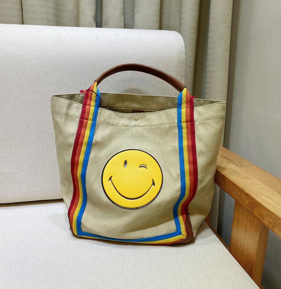黄色帆布包 anya经典帆布黄色笑脸包mini托特包彩虹织带购物袋tote托特包旅行_推荐淘宝好看的黄色帆布包