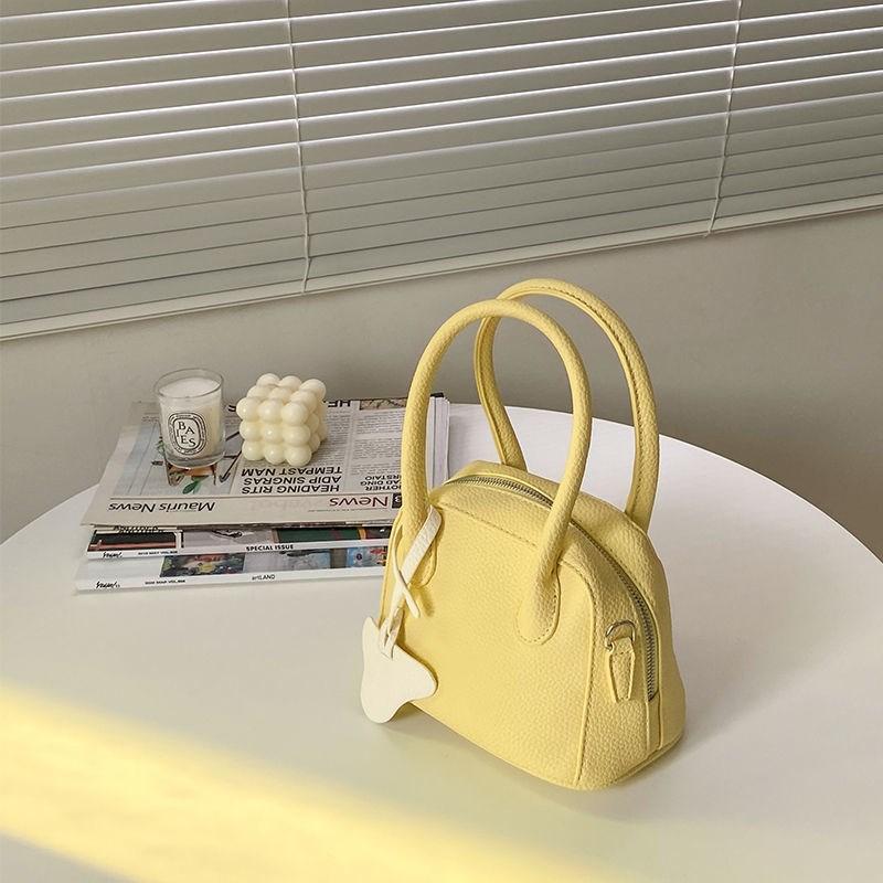 黄色贝壳包 奶黄色包包小小众设计奶黄色贝壳包女手提荔枝纹单肩斜挎包百搭包_推荐淘宝好看的黄色贝壳包
