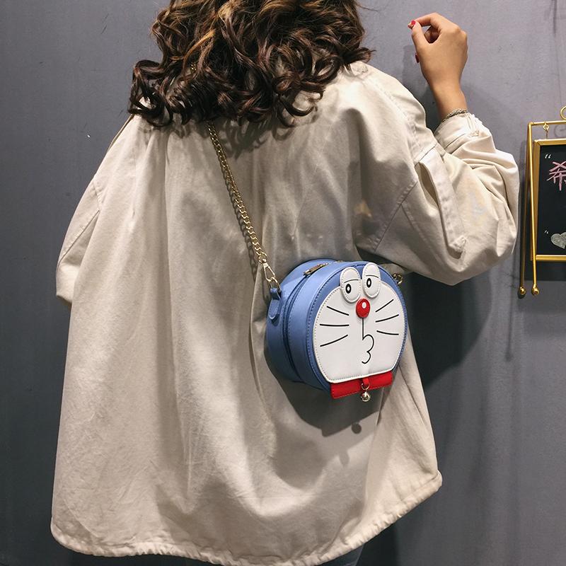 卡通斜挎包 卡通小包包女包2019新款潮日系学生可爱单肩包搞怪丑萌链条斜挎包_推荐淘宝好看的女卡通斜挎包