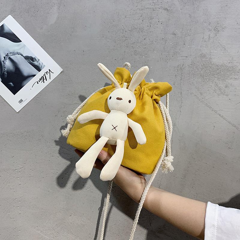 黄色水桶包 黄色轻便个性中学生小巧容量风卡通可爱斜挎包帆布运动型水桶单肩_推荐淘宝好看的黄色水桶包