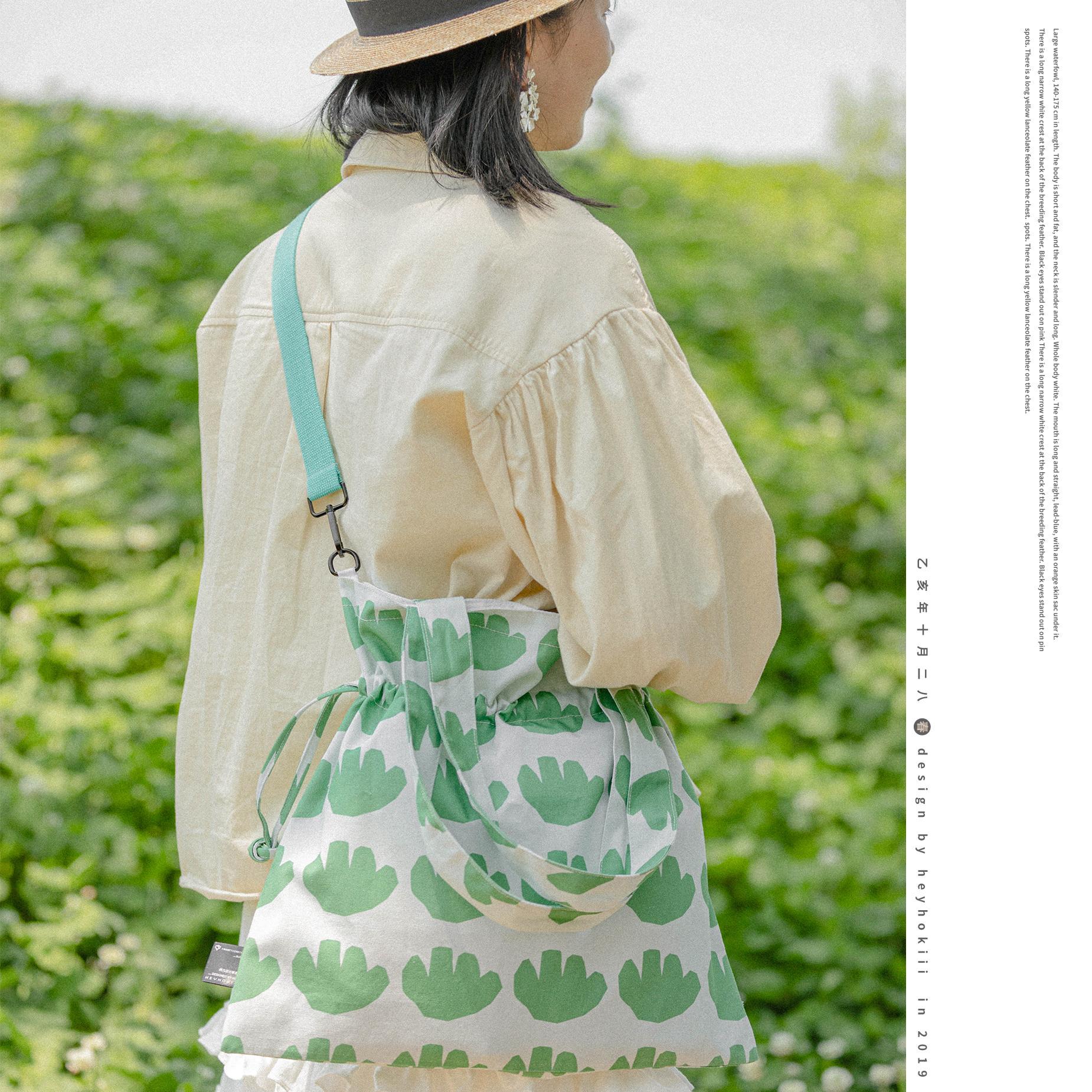 绿色帆布包 何几原创绿色春夏新品单肩斜挎抽绳花包包女帆布包女文艺小清新风_推荐淘宝好看的绿色帆布包