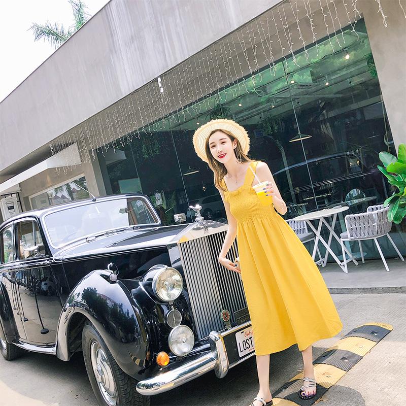黄色连衣裙 黄色吊带连衣裙女中长款a字无袖夏装2018新款ins超火的复古初恋裙_推荐淘宝好看的黄色连衣裙
