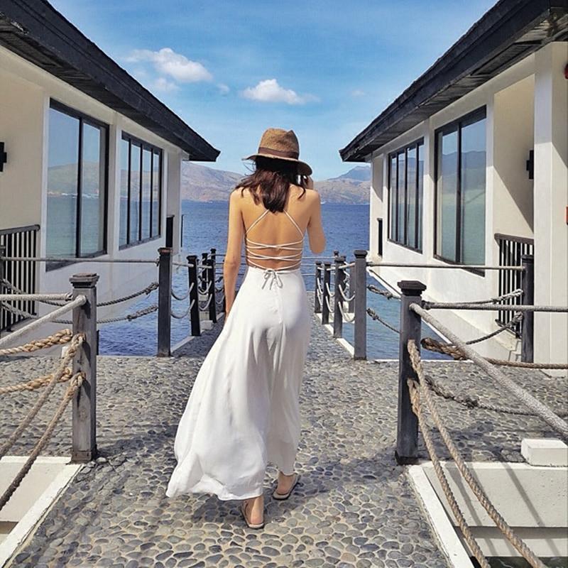 白色吊带连衣裙 巴厘岛沙滩裙夏2018新款海边度假性感露背吊带连衣裙波西米亚长裙_推荐淘宝好看的白色吊带连衣裙