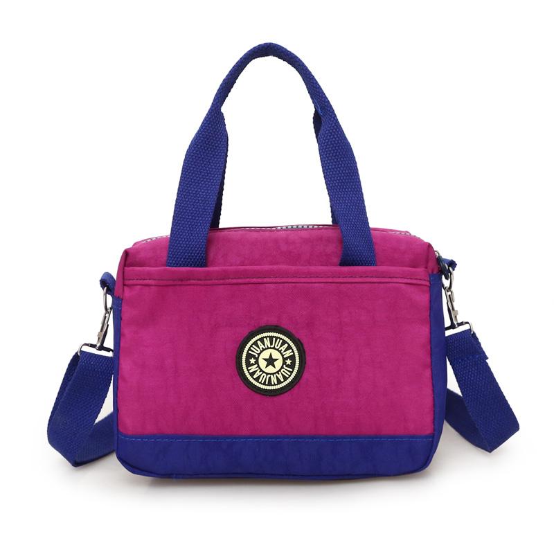 紫色手提包 休闲女包斜挎包2017新款手提小方包尼龙单肩包牛津帆布时尚包小包_推荐淘宝好看的紫色手提包