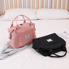 Travel bags ladies net red short-haul boarding bags large capacity light hand put forward poor travel receipt bags small