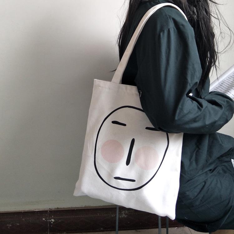 光敏变色帆布包遇到阳光害羞女单肩韩国ulzzang日系ins恶搞帆布包