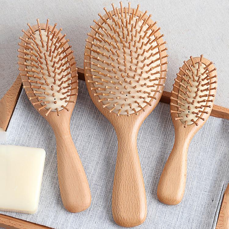 圆形气垫梳女气囊梳ins气垫梳子按摩梳可爱随身防静电实木梳子
